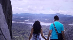 Couple holding hands, back view Stock Footage