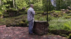 Man praying at the altar in outdoor church Stock Footage