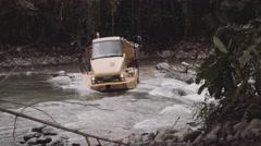 Heavy duty truck crossing river Stock Footage