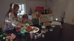 Children decorating ginger bread man at christmas 4k Stock Footage