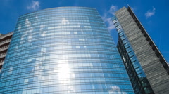 Glass facade of a modern buildings and clouds Stock Footage