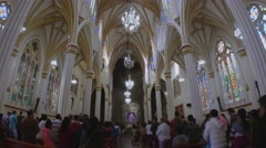 People hearing mass on beautiful cathedral Stock Footage