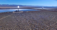 A beautiful aerial over a vast concentrated solar power farm in the Mojave Stock Footage