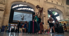 Milan, Italy - August 2016: Busy people at Stazione Centrale Railway Station Stock Footage