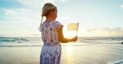Young Girl with American Flag on Beach Stock Footage