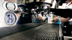 Barista blows up the steam from the coffee machine Stock Footage