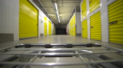 Cargo trolley is moving in the self-storage warehouse POV 4K Stock Footage