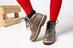 Close-up of woman wearing fashionable brown boots Stock Photos
