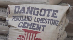 Dangote-branded cement bags being piled up. Stock Footage