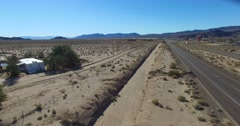 A billboard advertises a large tract of land in the desert for sale and ready Stock Footage