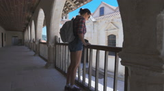 Tourist travels in Europe, sightseeing tour. A woman with backpack Stock Footage