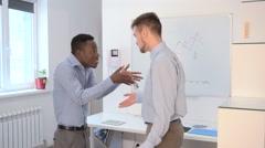 Businessman talking in office Stock Footage