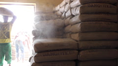 Dangote cement bags piled up in storeroom Stock Footage