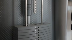 Power training apparatus with different weights in a fitness club Stock Footage