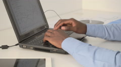 Male hands typing on laptop keyboard Stock Footage