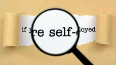 Magnifying glass on self employee text Stock Footage