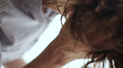 Girl dries hair a hairdryer Stock Footage