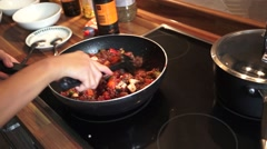 Cooking Bolognese on the Hob Stock Footage