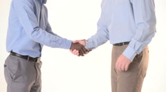 Two businessman shaking hands. close-up Stock Footage