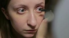 Makeup at home girl pass mascara Stock Footage