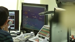 Operators are working in vessel traffic service center (Control Tower). Stock Footage