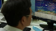 A operator is working in vessel traffic service center (Control Tower). Stock Footage