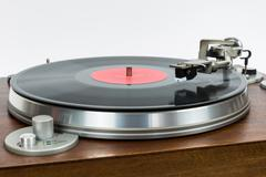 Closeup of turntable with vinyl record Stock Photos