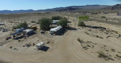 Aerial over a lonely desert outpost along a busy interstate. Stock Footage