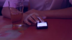 Handsome young man using smartphone in a bar with a glass of cider. Stock Footage