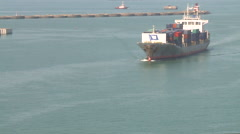A container ship is arriving at port, viewed from vessel traffic service center. Stock Footage