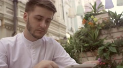 Young man tablet pc work. Handsome caucasian man using digital tablet computer Stock Footage