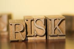 The word RISK out of metal blocks Stock Photos