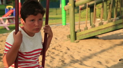 Boring cute little boy at the playground Stock Footage