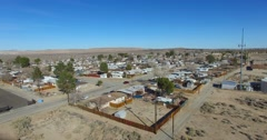 Aerial over a lonely desert community in the Mojave Desert of California. Stock Footage