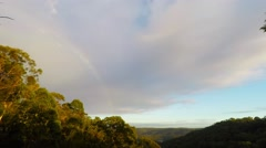 Morning Fog Clearing From the Valley with Clouds and Rainbow  Stock Footage