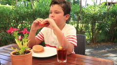Child in a cafe, eating hamburger 2 Stock Footage