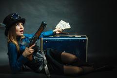 Steampunk girl with cash. Stock Photos