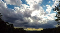 Afternoon Clouds Moving Over the Valley with Sunlight Breaking Through Stock Footage