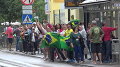 WYD Krakow 2016 - group of joyful brazilian people singing at tramway station Stock Footage
