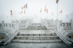 Flags in fog at Ngong Ping, on Lantau Island, Hong Kong. Stock Photos