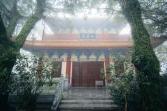 Historic building in fog, at Ngong Ping, Lantau Island, Hong Kong. Stock Photos