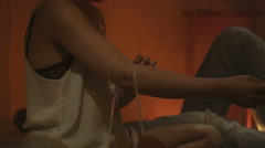 4K Drug addict woman in gloomy apartment injecting herself in the arm Stock Footage