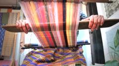 Woman working on backstrap loom Stock Footage