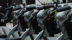 Urban bike rental station Stock Footage