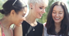 Young female friends socialising outdoors Stock Footage