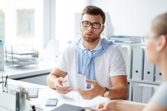 Male Manager Explaining Task Stock Photos