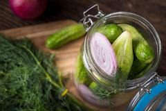 Preservation cucumber with dill and onion. Branch seasoning aromatic spice an - stock photo