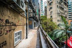 Walkway and buildings at Lan Kwai Fong, in Hong Kong. Stock Photos