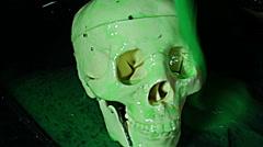Skull covered in slime horror movie Stock Footage