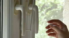 Detail Of A Man's Hand Opening A Double Window, Side Shot, Hand Held Camera Stock Footage